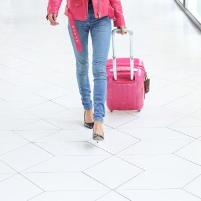 Woman_Walking_with_Carry_on_luggage