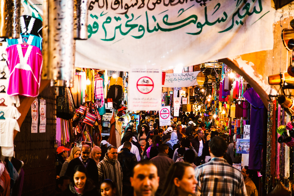 people shopping in a souk