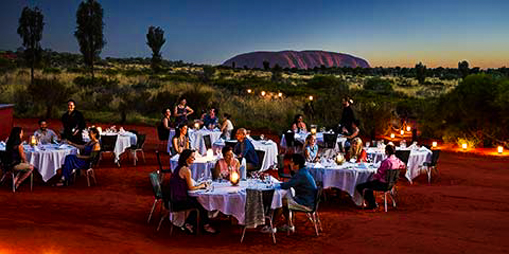 Tables_set_for_meal_in_desert_Uluru