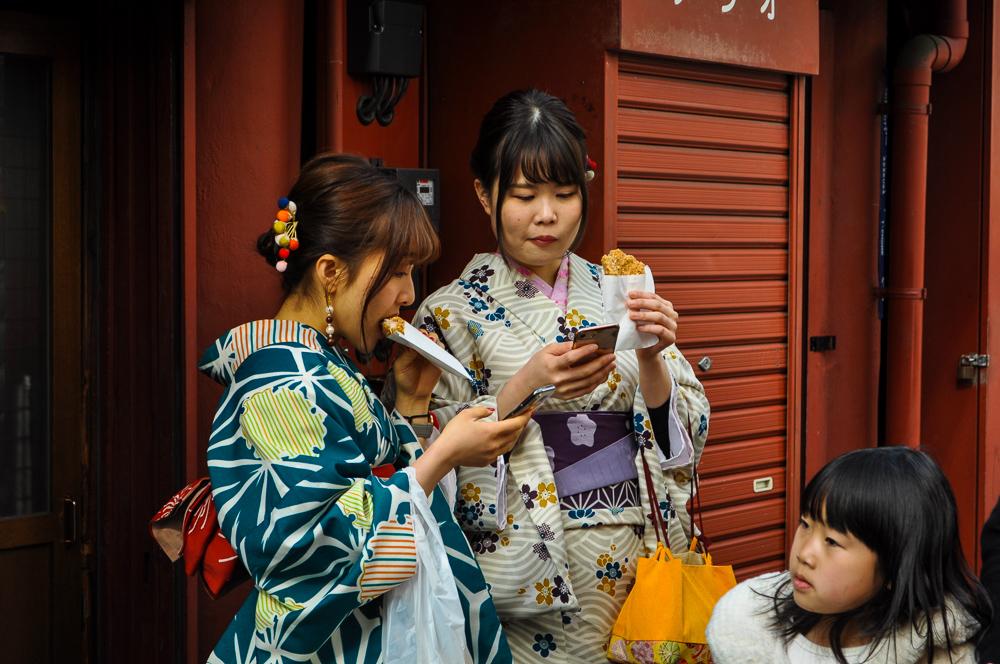Asian-ladies-having-street-food