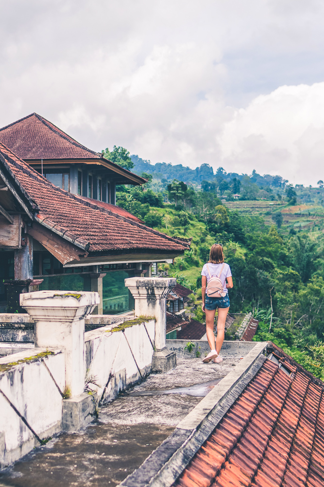 woman-overlooking-jungle-from-a-roof