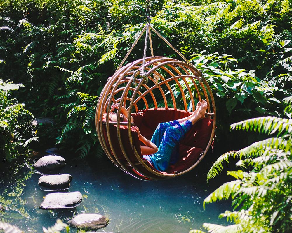 woman-over-water-in-basket-swing