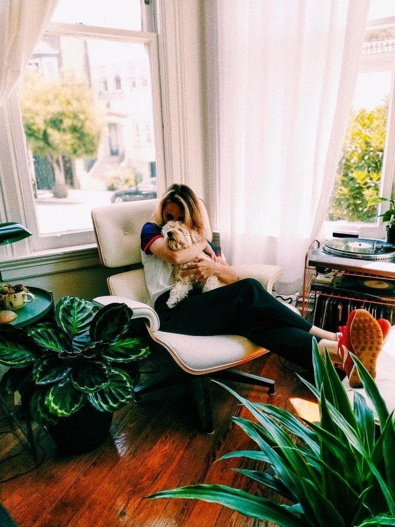 woman-cuddling-dog